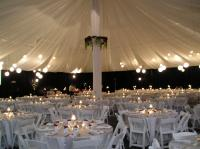 Beautiful Wedding set-up on a tennis court.  Design Events can truly change your venue into your dream wedding.  Add some ceiling voile, lantern lighting and decor