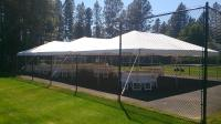 Tent set up on tennis court if it can be done our crew can do it!