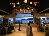A view of the Paper Lantern Lighting with Bistro Lights, lead right out to the patio and view overlooking the Lake.